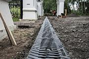 Строительство системы сбора и отведения сточных вод на парковке, июнь 2014 г.