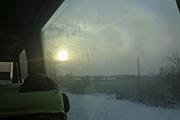 На обратном пути мы стали свиделями редкого зимнего явления - двойной радуги.